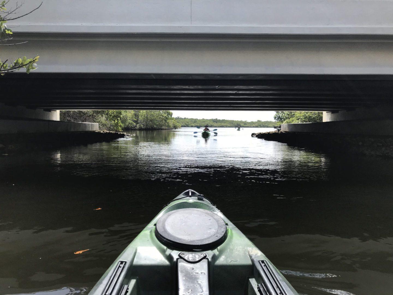 Kayak under bridge